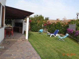 Casa con giardino ed ampie verande