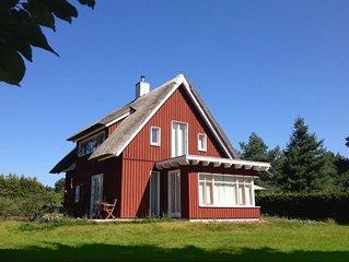 Ferienwohnung im reetgedeckten Holzhaus - sehr ruhig und idyllisch gelegen