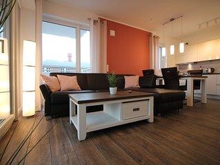 Rollstuhlgerechte-Neubau Ferienwhg.  W48 4 Pers. WLAN , 3xSmart TV, Tiefgarage