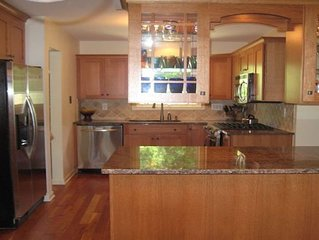 Kitchen with island between kitchen and dining room