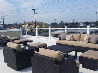 Oceanside private Second floor with Roof Top Deck Center of Harvey Cedars