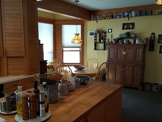 Kitchen dining area has seating for up to 6 (there is also a formal dining room)