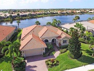 Luxury Lake Side Home at Venetian Golf & River Club with heated salt water Pool