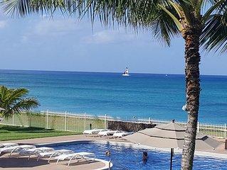 Beach Bohemian direct oceanfront, ground floor corner unit -- on the sunny side!