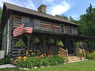 Enjoy this restored, old log home with recently completed renovations