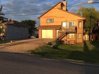 Beautiful Sylvan Lake waterfront property with unobstructed beach access.
