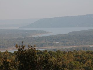 Ozark Oasis has a stunning view with lots of room to relax! Minutes from lake!