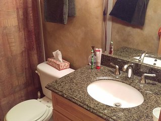 Come stay at this very nice 2 bed 2 bath top floor condo with vaulted ceilings.