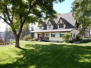 Quiet Country Tudor Home on Acreage with Incredible Lake and City Views