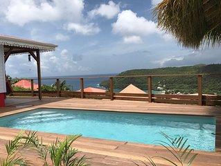 Villa neuve avec piscine, vue magnifique sur la mer des caraibes, 1' de la plage