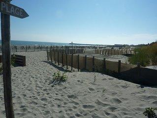 Duplex climatise a deux pas des plages et du centre du village