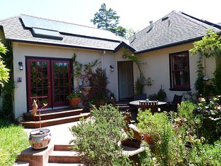 Bright, charming 4 BR Berkeley home, with beautiful patio and yard.