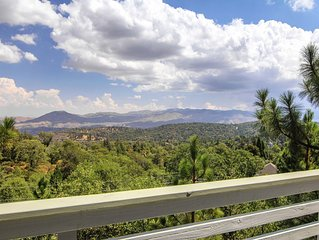 5-BR charmer with stunning mountain views and lake access