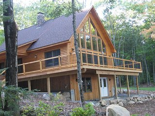 Beautiful waterfront log cabin on pristine Maine lake