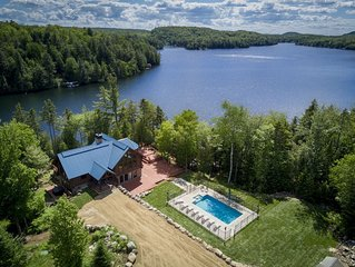 5 Bed/4 Bath huge chalet with heated pool/spa on the lake
