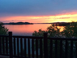 Luxury Douglas Lake cabin with backyard private dock to relax, swim and fish!