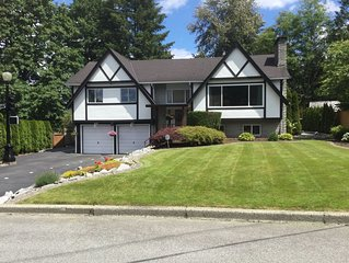 Tudor-style 4 bedroom on large lot with creek in back, near outdoor recreation.