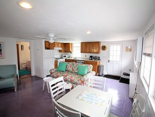 Relaxing 1-bedroom cottage w/ patio, yard, and grille steps to Surf Drive beach