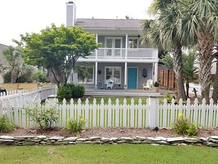 Airlie Road Cottage renovated with double front porches, palm trees and WiFi