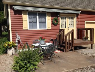 The Little Red Cottage is situated in a quaint country neighborhood