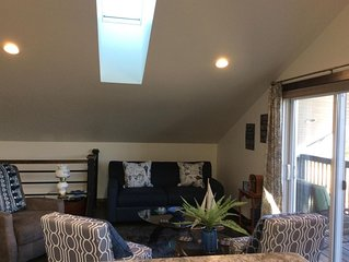 Living room with pull out couch to house extra guests. Skylight throughout!