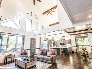 Great Room - Shiplap siding, driftwood cabinets, granite counters. view windows