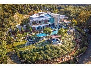 Private Custom Modern Estate, nestled on 15 acres with 11,000 sq. ft. of  luxury