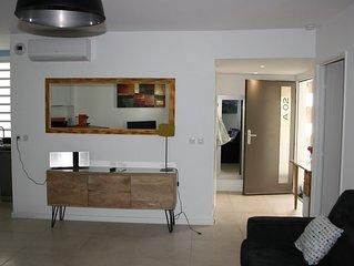 Appartement T2 avec piscine Hermitage à 150 m du lagon.
