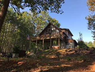 WATERFRONT LOG HOME! LARGE FLAGSTONE PATIO WITH FIRE PIT, DECK, HOT TUB, 77' TV