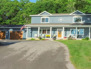 Beautiful view of the West Gd Traverse Bay in a new home, only 4 miles from