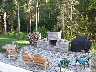The outdoor stone patio with fireplace