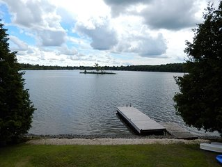 Waterfront Cottage-Sleeps 10 Guests-Large Dock-6 Boats-Summer weeks available
