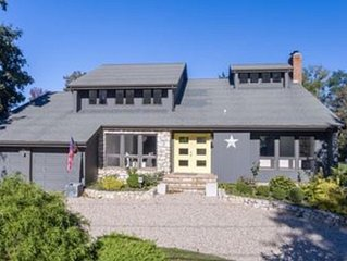 5 Bedrooms ~ Steps from a Private Sandy Beach and Beautiful Vineyard Views..