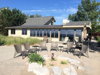 Amazing location on Lake Michigan 75 ft pvt beach, views of Grand Haven pier!