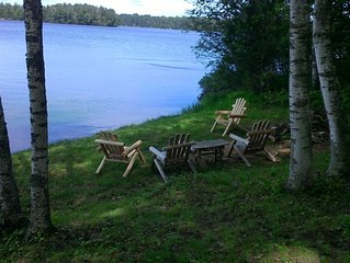 Nostalgic and comfortable home on large two connecting lakes.  Pier with boat.