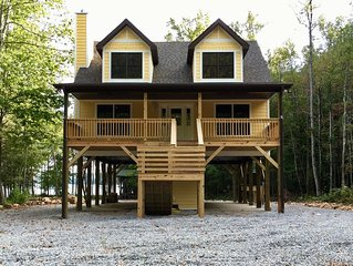Waterfront home nestled in the wooded privacy of Dales Creek Cove on Lake James