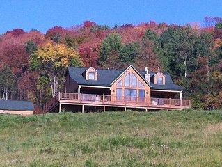 Large log home with 5 bedrooms, 4 baths, sleeps 12+, 2 large 60 ft. decks,hot tu