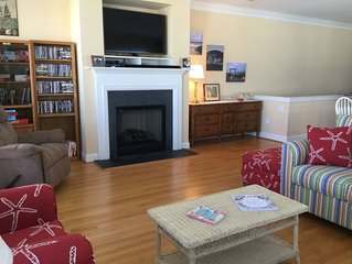 LR w/ gas fireplace, 50' 4K smart TV, DVD, cable, & library w/DVDs books & games