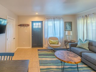 Newly Renovated Beach Front Condo with Private Garden Access