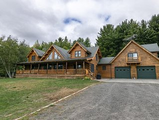 Cedar Log Home sits on 41.87 private acres with mountain and meadow views