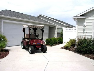 Great location,.  Golf Cart.  private courtyard villa between 466 and 466A