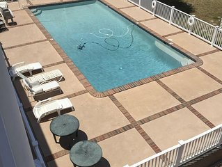 2-Bd Condo, Pool and Views of Sunset Lake. Watch the fireworks from the porch!