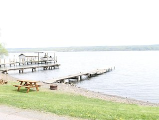 Lovely, level lake front/beach area with picnic table and dock