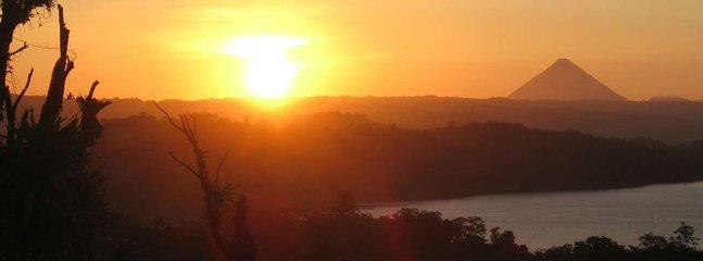 Amazing sunrise over Lake Arenal and Arenal Volcano