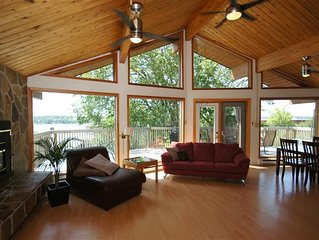 Living room & dining room with lake in the background off front deck.