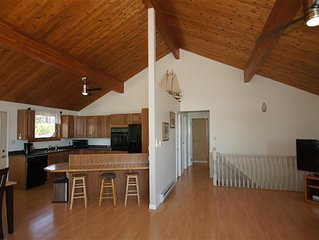 View of open living area including living room, dining room and kitchen.