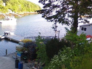 Our comfortable cottage sits on a dock close to town, over looking Lobster Cove