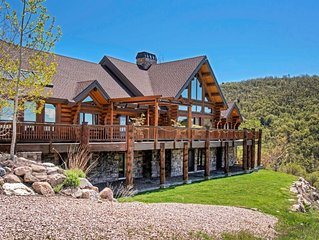Custom log home nestled in the mountains. Stunning valley views from every room.
