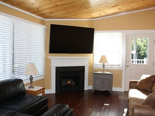 DEEP DISCOUNTS OFF SEASON! Renovated cottage. 70 inch HDTV.  Propane fireplace