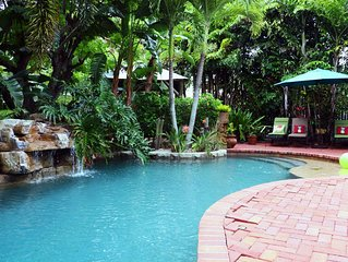 Tropical bungalow oasis; heated pool with rock waterfall and hot tub. Sleeps 8!